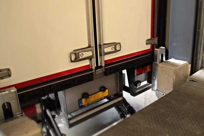 Docked trailer against PE-M Height Adjustable Dock Bumpers